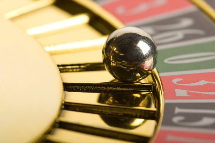 Close-up of a golden roulette wheel